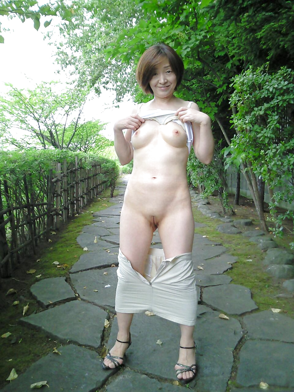 Uncensored shaved outdoor asian